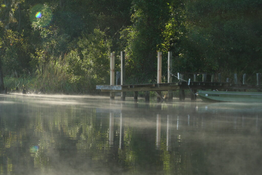 Old pier and punt, early morning, Sidney Creek, NC.